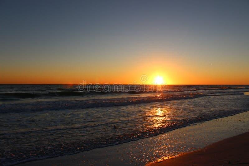 Por do sol na praia de Lido fotografia de stock royalty free