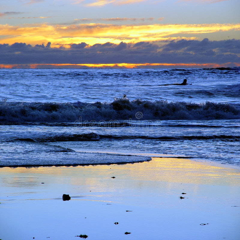 Por do sol na praia do CA fotos de stock