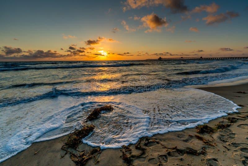 Por do sol na praia imperial, CA fotografia de stock royalty free