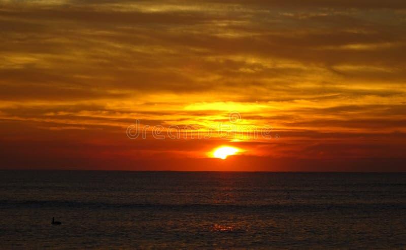 Por do sol na praia, Oaxaca imagem de stock