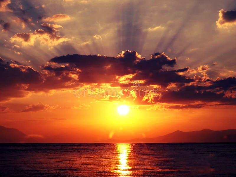 Por do sol no mar foto de stock