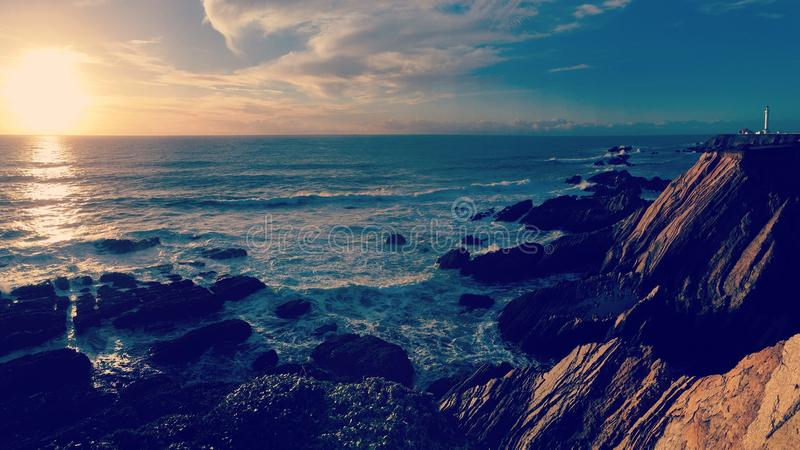 Por do sol no ponto fotografia de stock royalty free