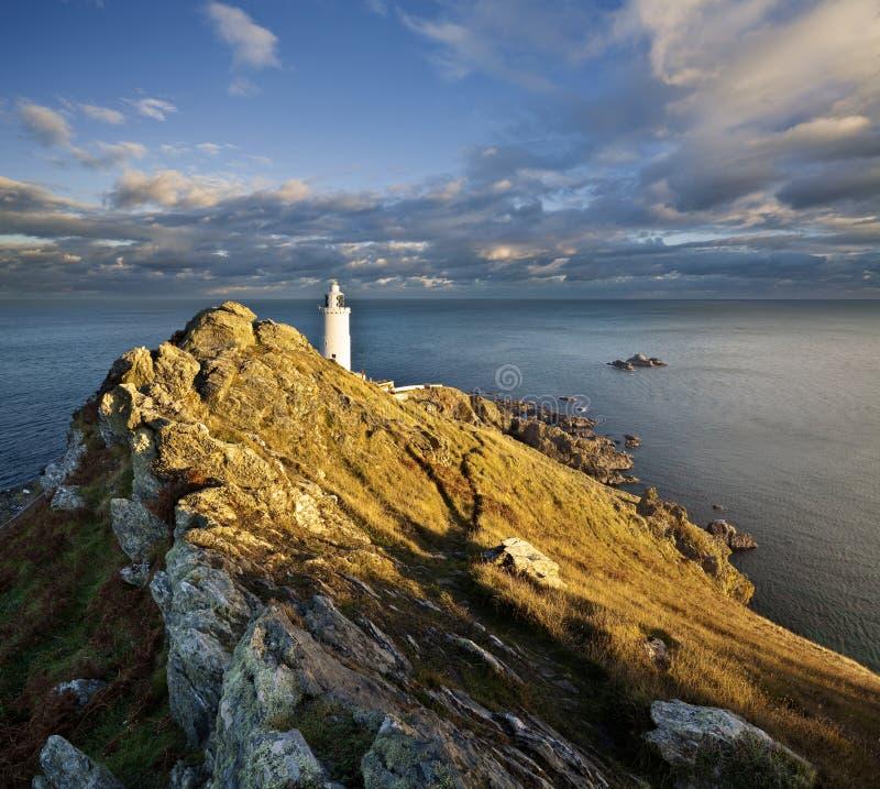 Por do sol no ponto do começo na costa sul do ` s de Devon imagens de stock