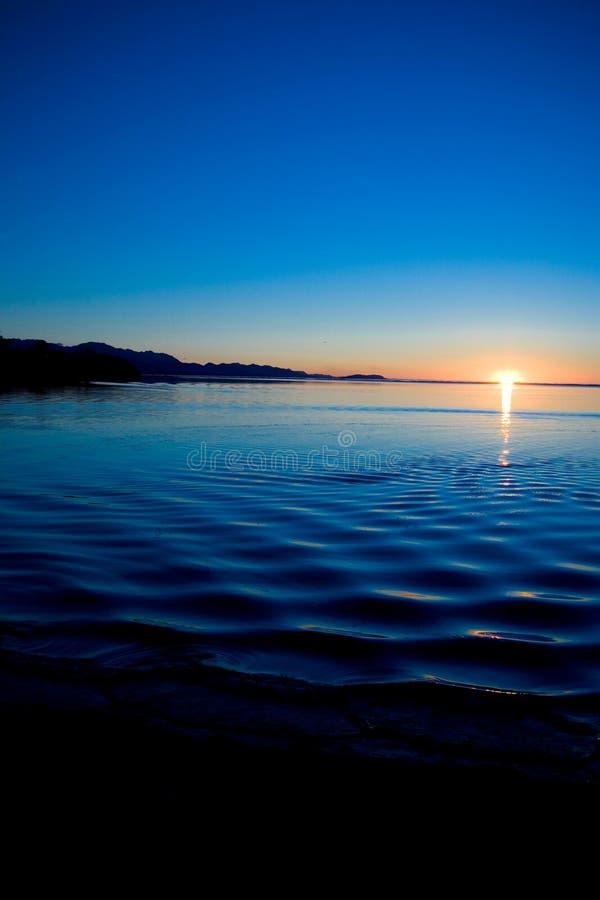 Por do sol noroeste pacífico imagem de stock