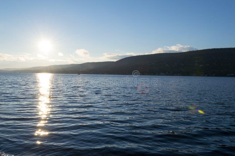 Por do sol pelo lago greenwood (NY) fotografia de stock royalty free
