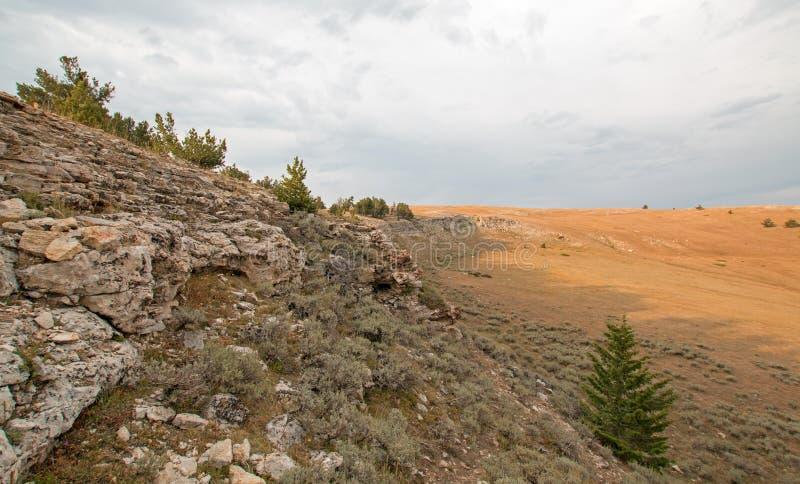 Por do sol sobre a garganta da xícara de chá como visto de Tillett Ridge nas montanhas na fronteira estadual de Wyoming Montana - fotos de stock royalty free