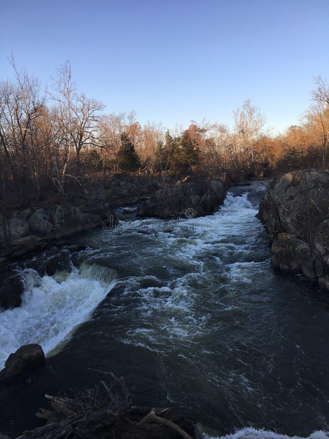 Por do sol sobre quedas em Great Falls, DM fotografia de stock royalty free