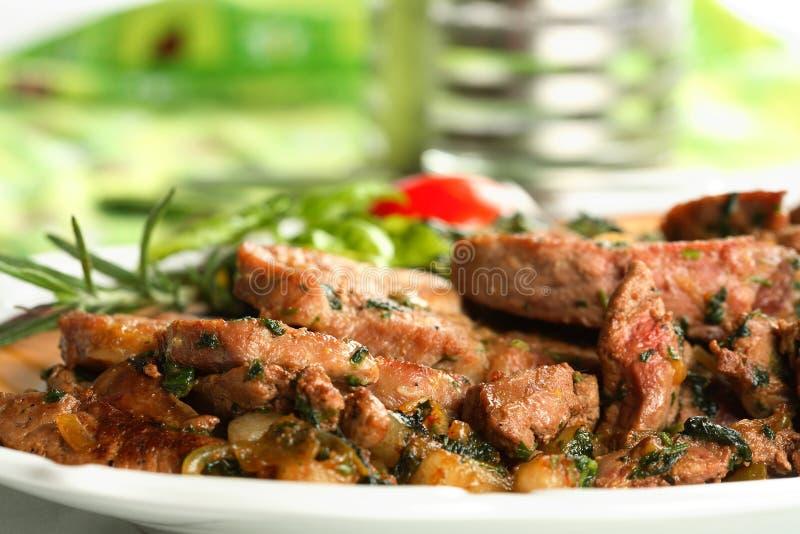 Porc avec des pommes de terre de four image stock
