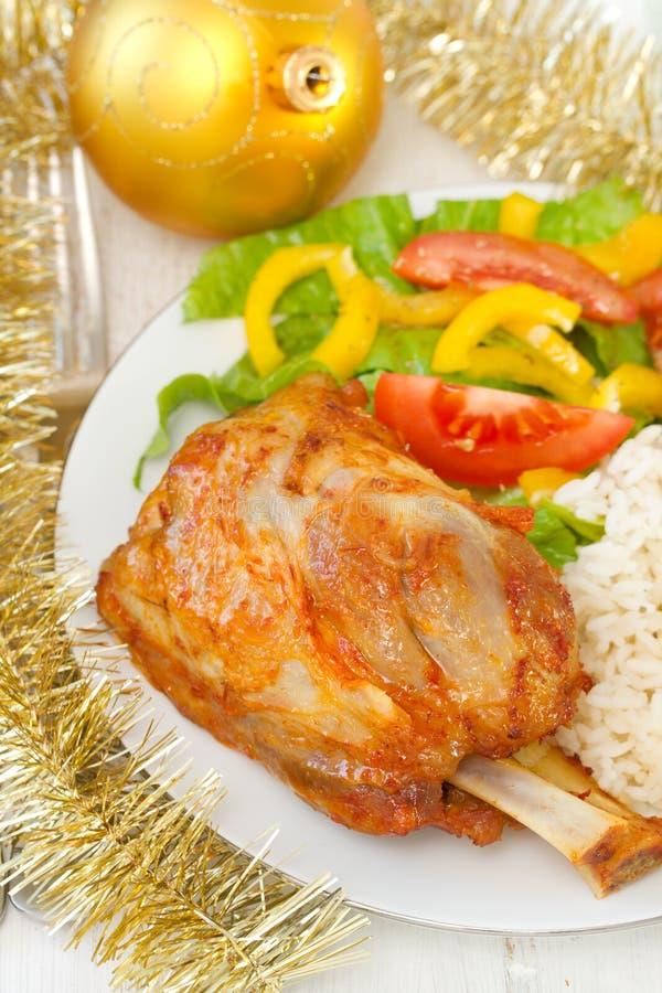 Porc avec du riz et la salade photo stock