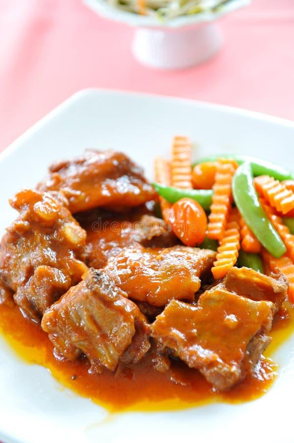 Porc avec la sauce au jus photographie stock libre de droits