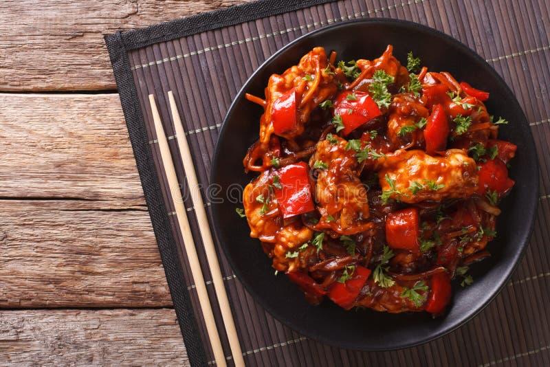 Porc braisé en sauce aigre-doux avec des légumes en gros plan H photographie stock libre de droits