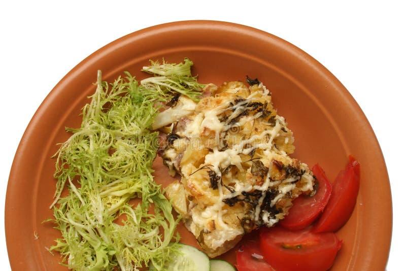 Porc cuit au four avec des vegetabels images stock