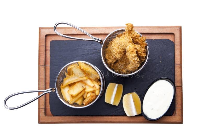 Porc et Fried Potato grillés délicieux avec de la sauce et le citron o images stock
