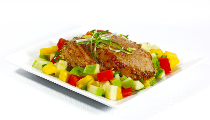 Porc et salade frits image stock
