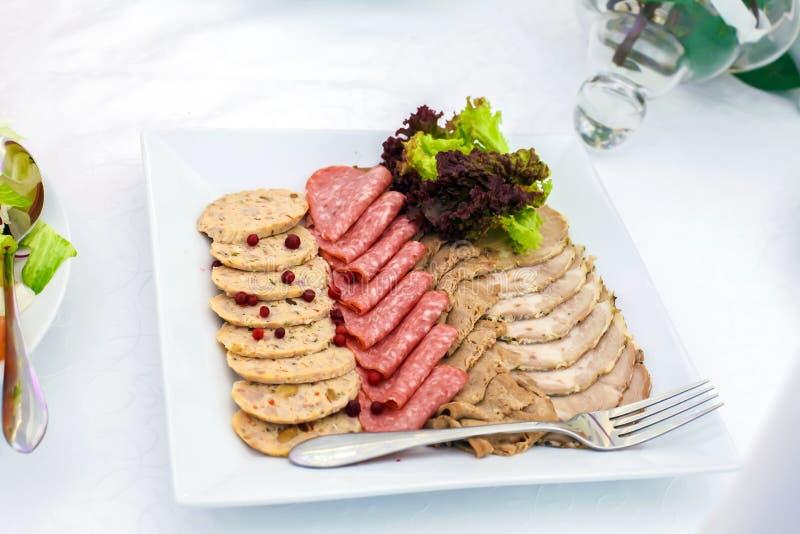 Porc et saucisse coupés en tranches photographie stock