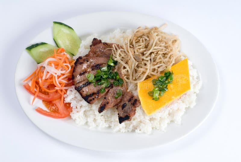 Porc grillé au-dessus de riz photographie stock