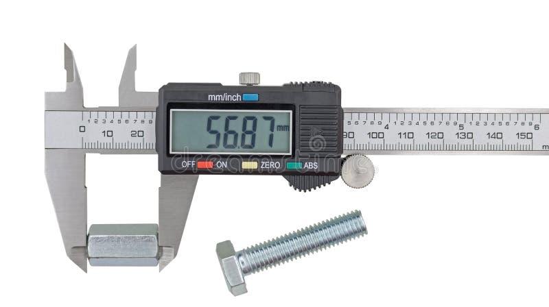 Porca de aço grande de medição com compassos de calibre vernier foto de stock royalty free