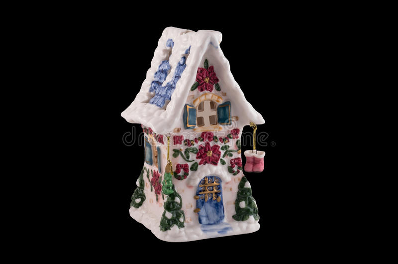 Porcelain Christmas house (isolated on black) royalty free stock photography