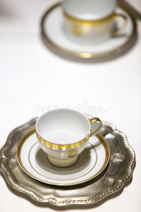 Porcelain coffee cups on white table. Luxury and romantic coffee. Set of classical porcelain coffee cups on table with white tablecloth royalty free stock photography