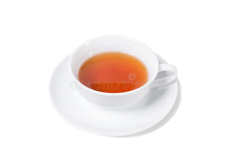 Porcelain cup of aromatic black tea. Isolated on a white background royalty free stock photography