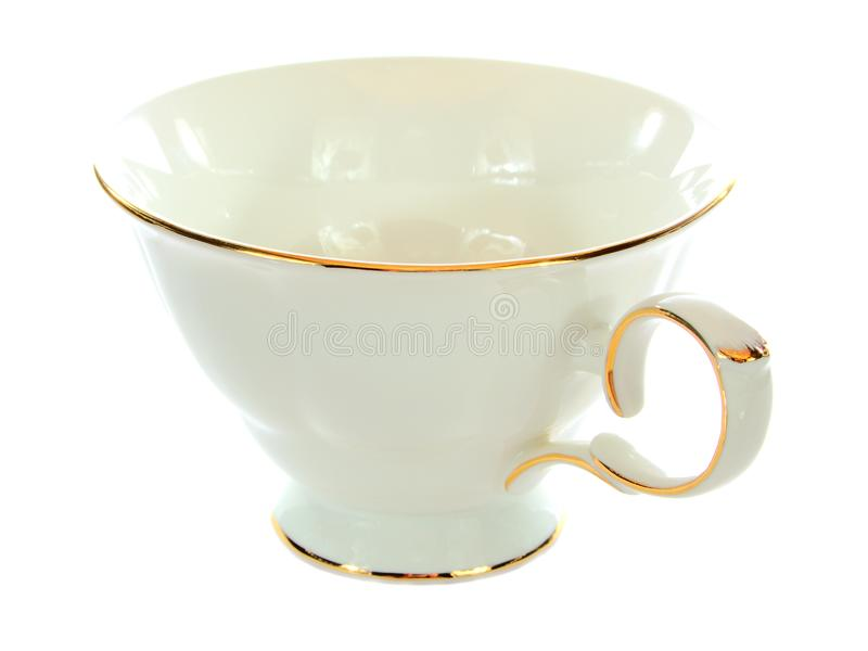 Porcelain cup with a gold rim, general view. Isolated object on a white background, closeup royalty free stock image