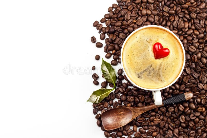 Porcelain cup of hot coffee. Roasted coffee beans. Heart symbol. Food trading. Fair trade coffee. Food photography. royalty free stock photography