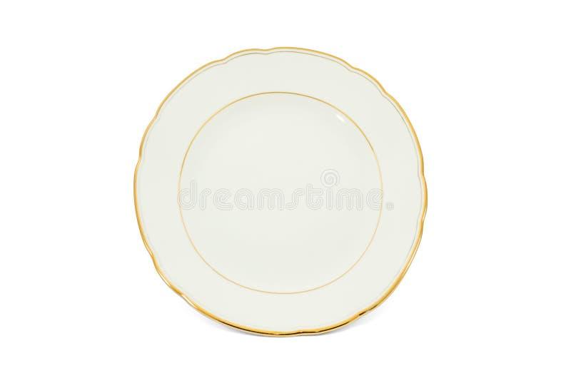 Porcelain dish. Old-fashioned porcelain dish with gilded border isolated on white background stock photos