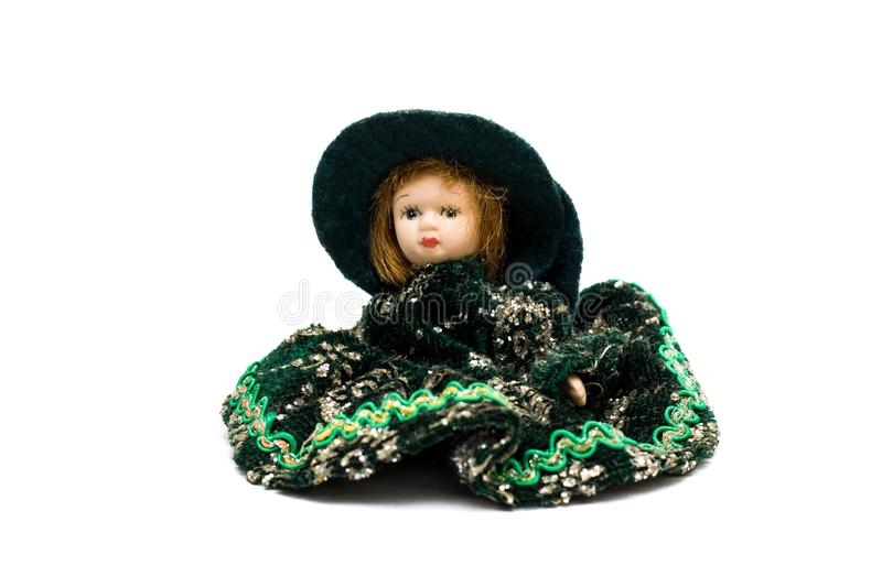 Porcelain doll in a green dress royalty free stock photography