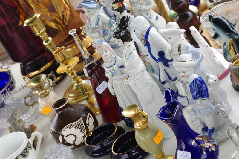 Porcelain figurines decorative objects flea market. Home related royalty free stock image