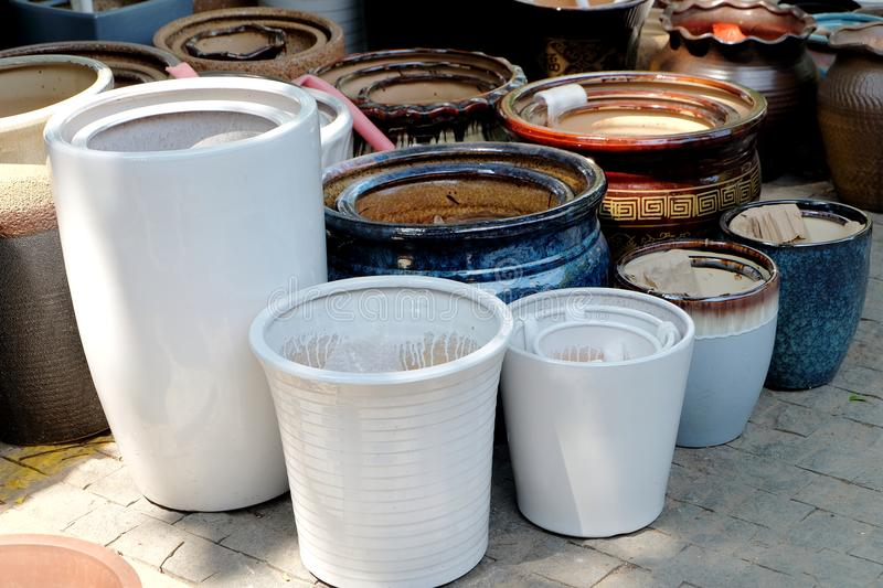 Porcelain pots in rows stock photography