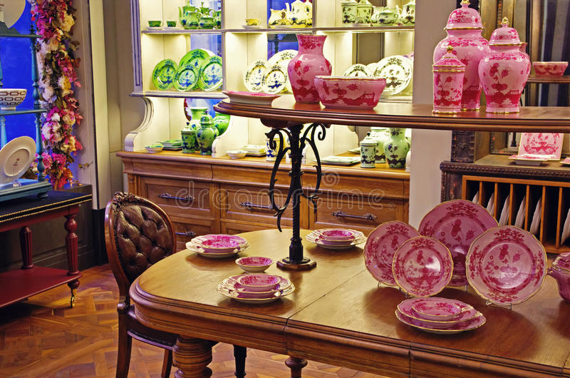 Porcelain pottery shop. Variety of porcelain pottery, dishes and mugs, displayed in a pottery shop. Florence, Italy stock image