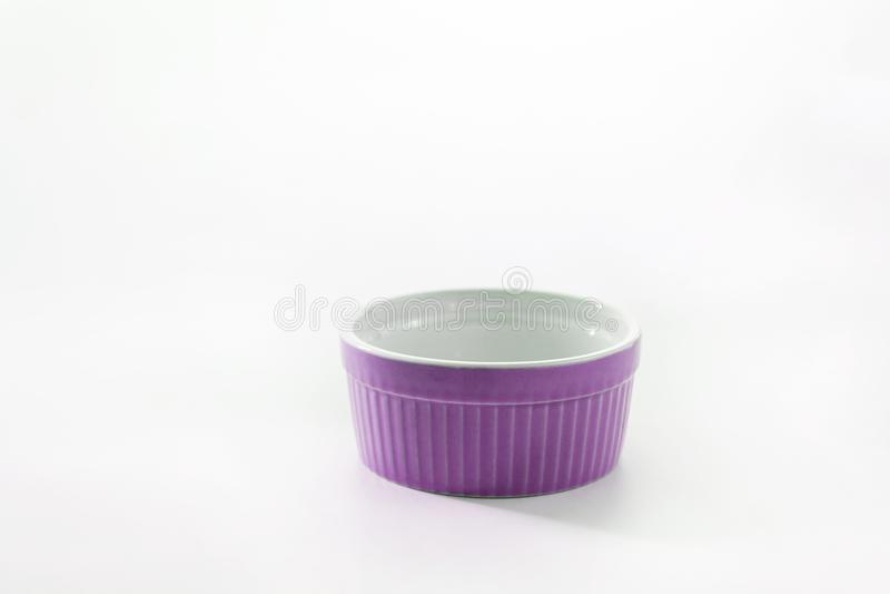 Porcelain souffle ramekin dish isolated on white background.  royalty free stock image