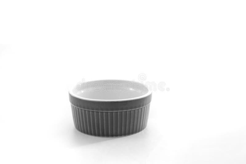 Porcelain souffle ramekin dish isolated on white background.  stock images