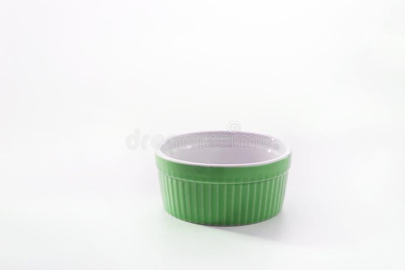 Porcelain souffle ramekin dish isolated on white background.  stock photos