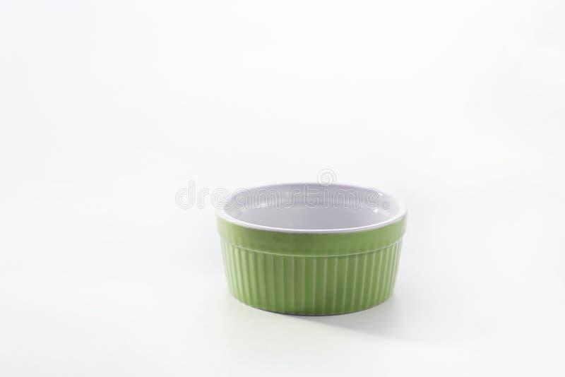 Porcelain souffle ramekin dish isolated on white background.  royalty free stock photos