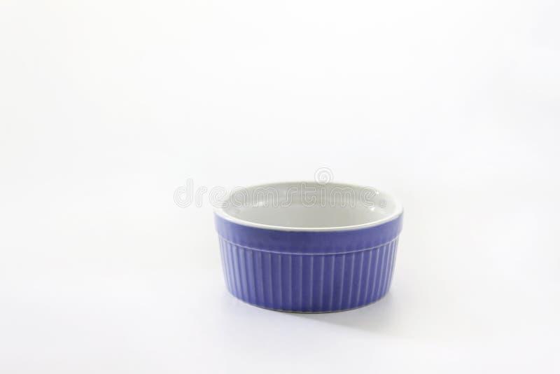 Porcelain souffle ramekin dish on white background.  stock images