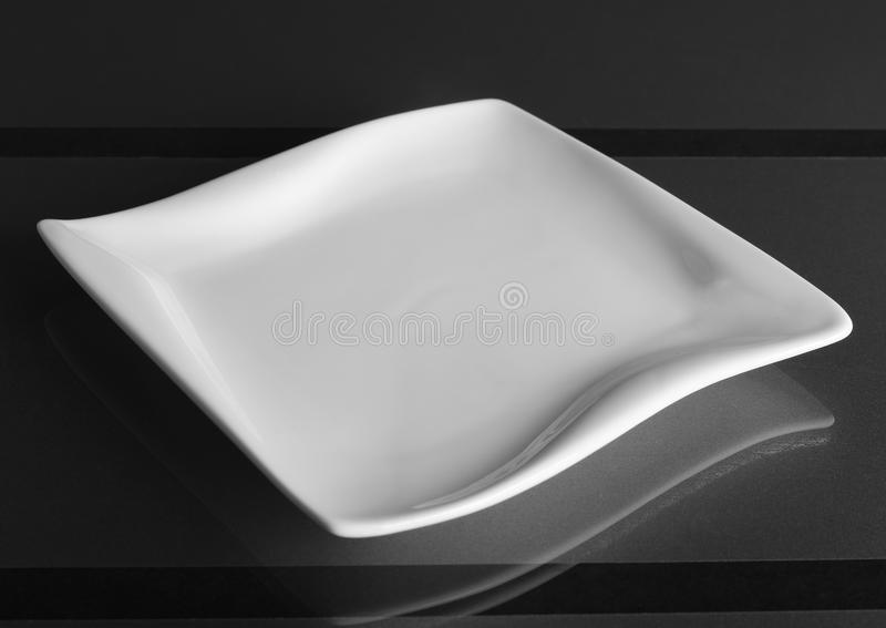 Porcelain square shallow bowl royalty free stock photo
