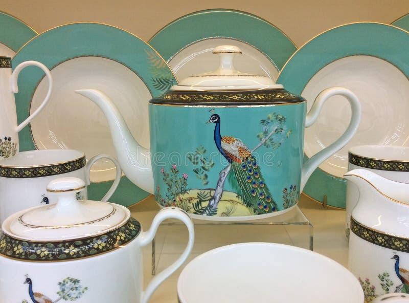 Porcelain tea pots and cups royalty free stock photos