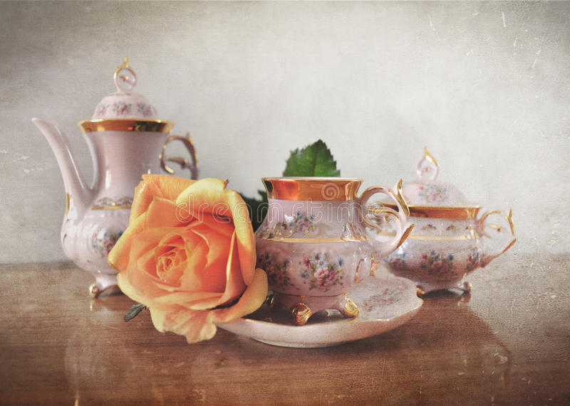 Porcelain tea set with retro vintage Instagram style effect. And grunge filter royalty free stock image