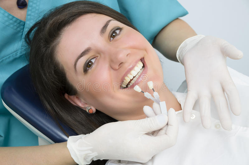 Porcelain Teeth. A dentist showing porcelain teeth to pacient stock photos