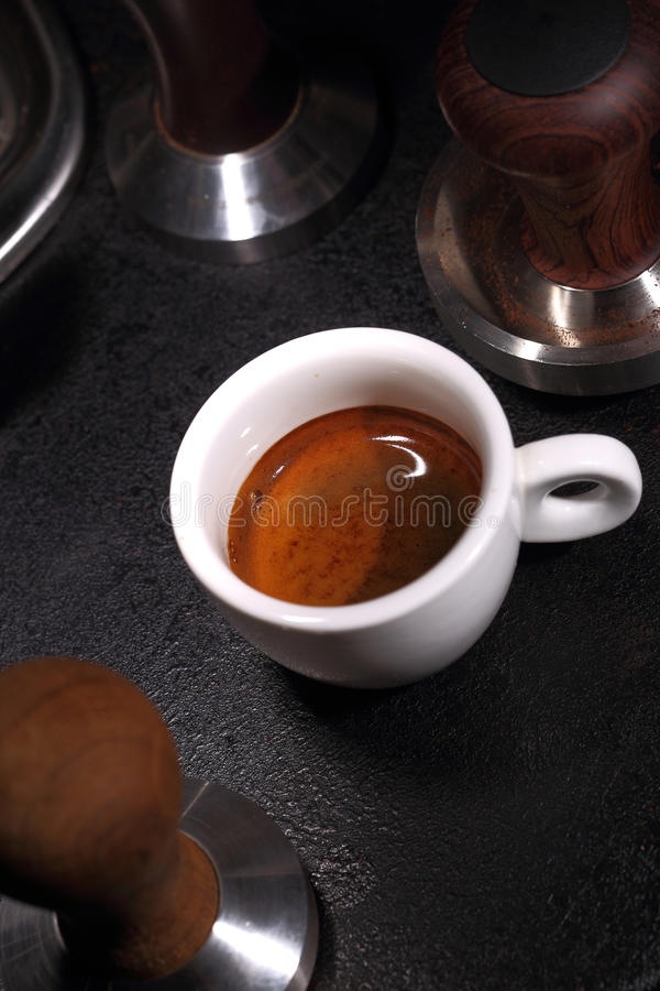 Porcelain white cup of espresso coffee stock images