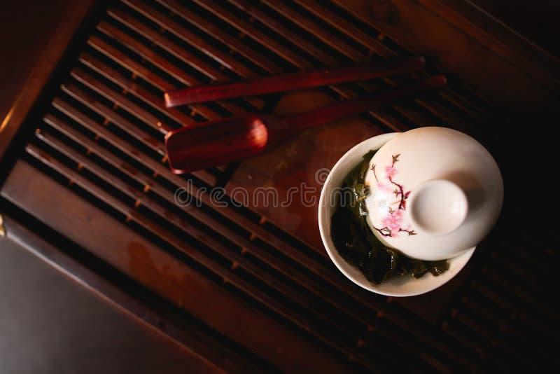Porcelain white gaiwan on tea desk chaban. Chinese tea ceremony. Porcelain white gaiwan on tea desk chaban. Top view stock photography