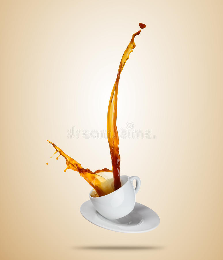 Porcelaine white cup with splashing coffee or tea liquid separated on brown background. Hot drink with splash, beverages and refreshment. Copyspace for text royalty free stock images