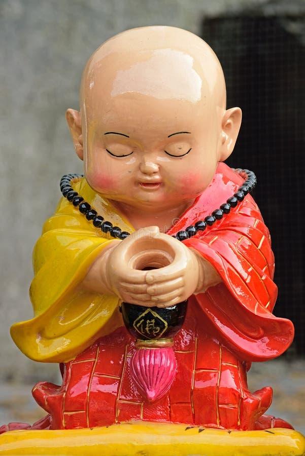 Porcelana: A monge pequena fotografia de stock
