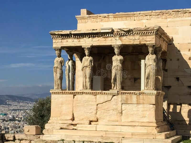 Porch of the Caryatids. The Erechtheion or Erechtheum is an ancient Greek temple on the north side of the Acropolis of Athens in Greece which was dedicated to stock image