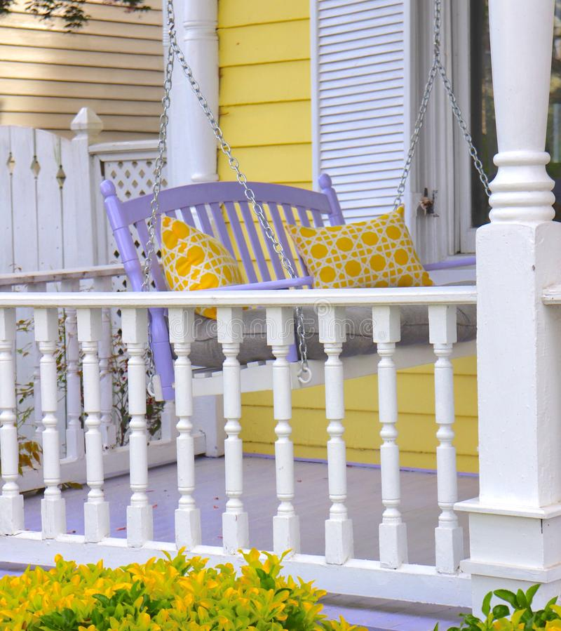 Porch Decor With Lavender Swing and Yellow Pillows stock images