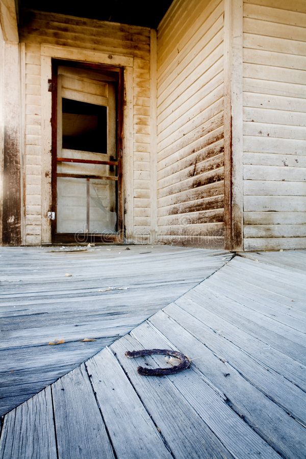 Porch with horse shoe royalty free stock image