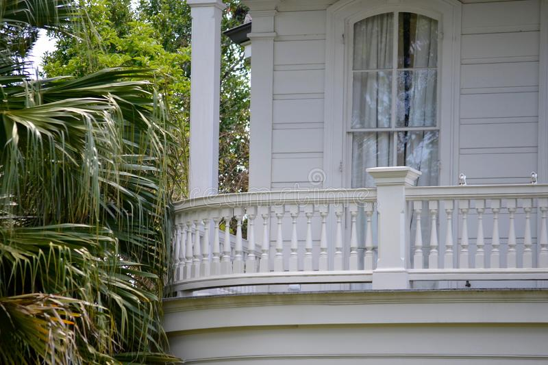 Porch on house exterior. Close up of porch outside white home in southern USA on sunny day stock images