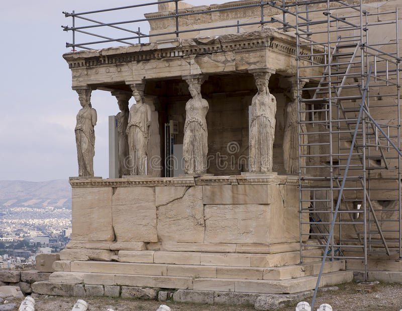 The Porch of the Maidens. The famous Porch of the Maidens with six draped female figures caryatids as supporting columns, located on the north side of the stock photo