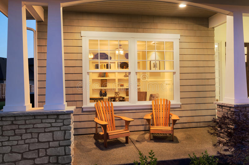 Porch outside New Home. Porch at night with interior view royalty free stock image
